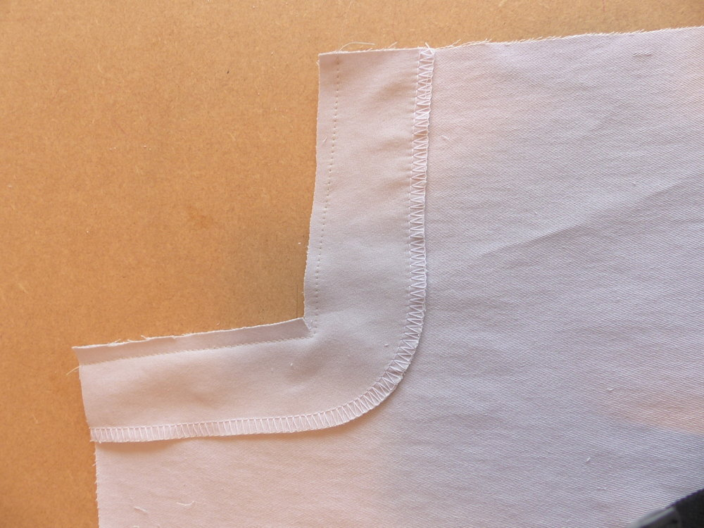 Jeans with a bulk-free pocket method. Trim and slash to the corner, then understitch/topstitch