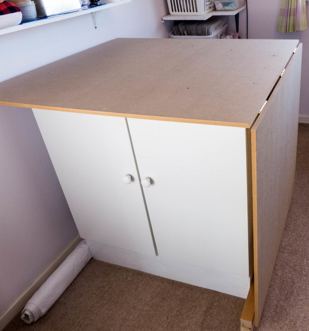 DIY folding cutting table with storage