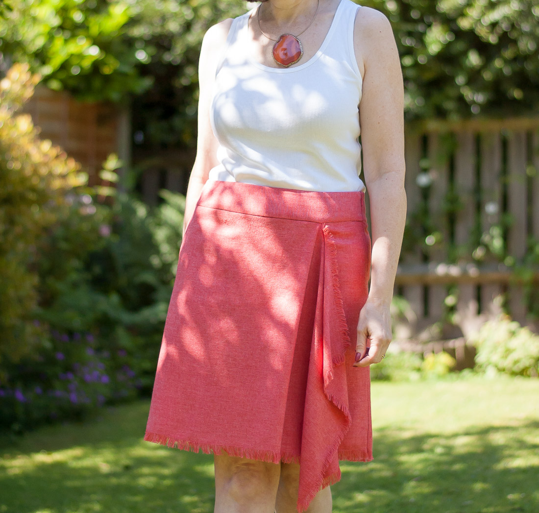 Coral skirt with wrap and fringe edges