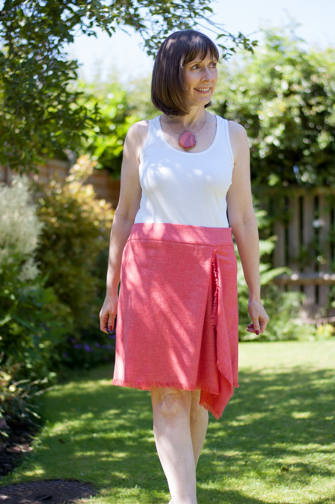 Coral wrap skirt with drape