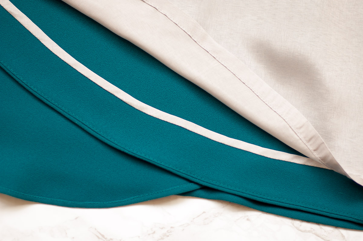 Hong Kong binding on curved hem facing.  My designer look for less, the big reveal.