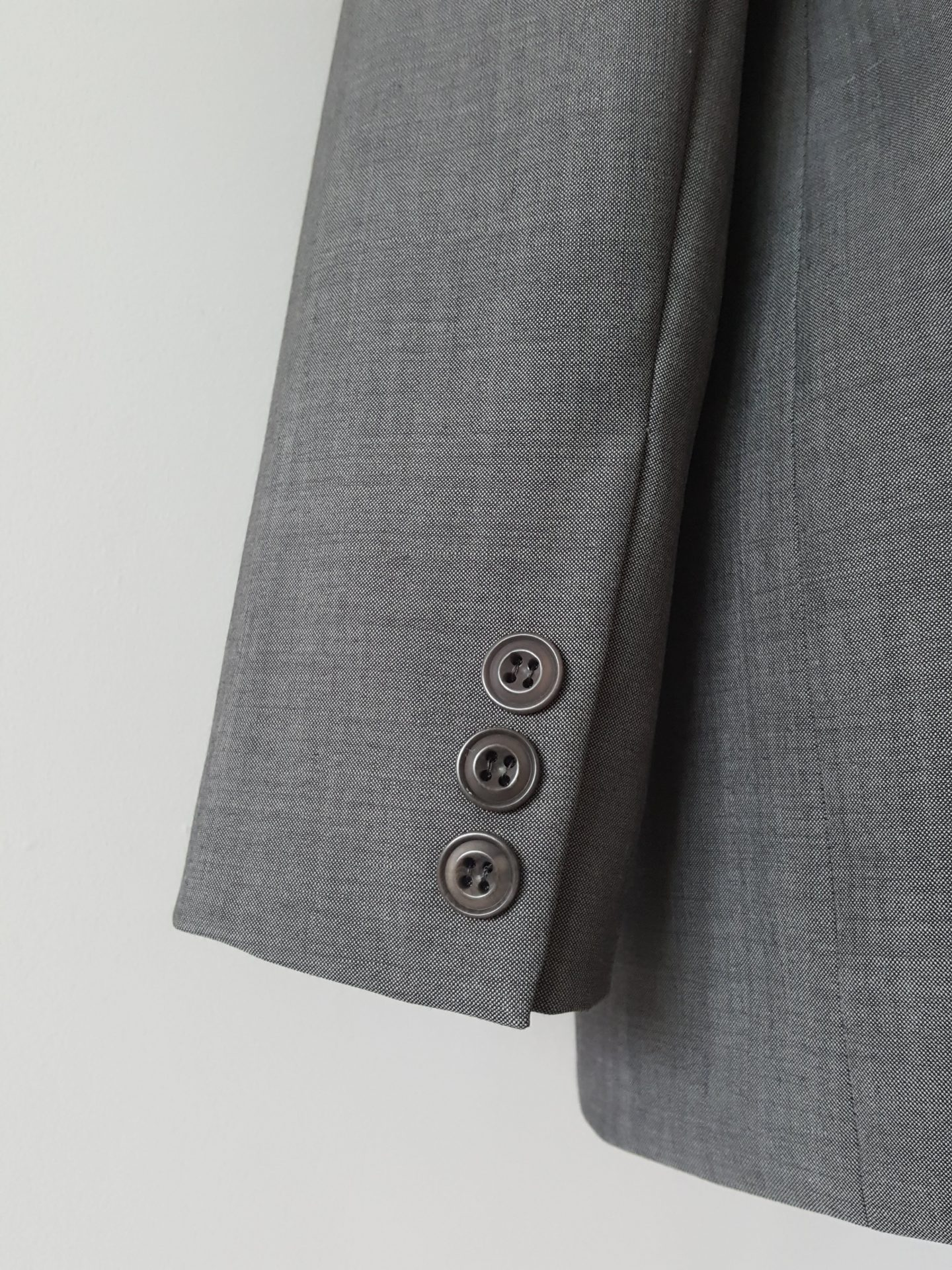 Sleeve vent detail of grey boyfriend blazer