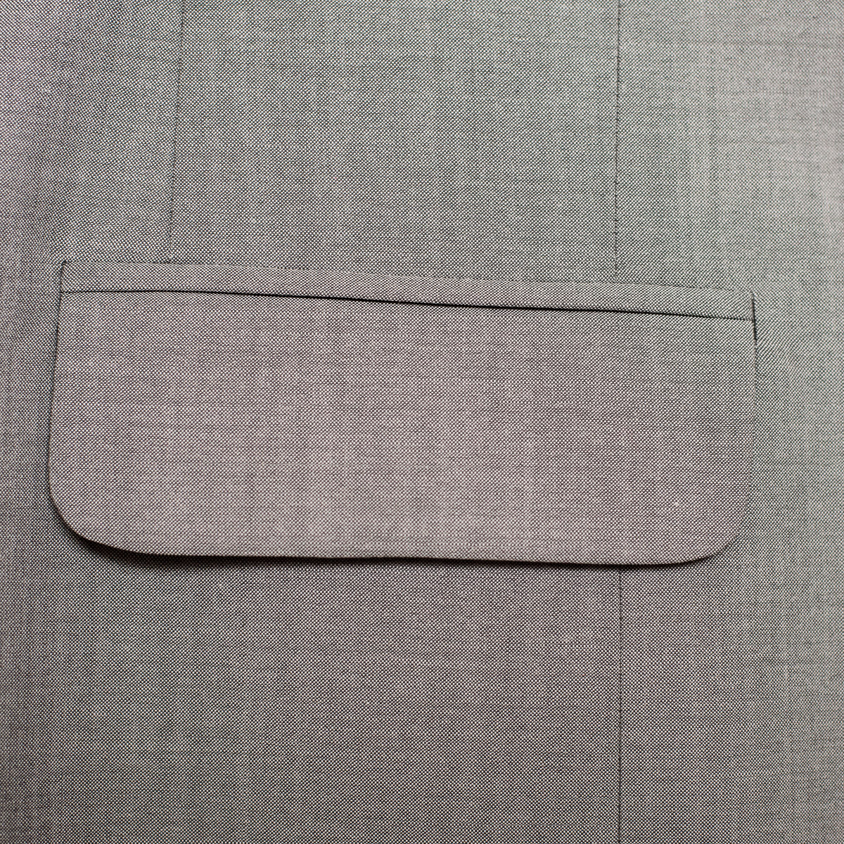 Double welted pocket with flap.